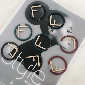 Pendientes Marca FF de moda para damas estilo simple encanto de las mujeres pendientes de la manera redonda Carta pendientes regalo