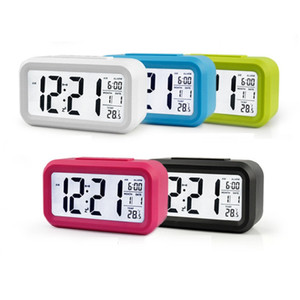 المنبه الرقمية شاشة LCD غفوة ساعة إلكترونية ضوء استشعار شمعة العرض الرقمي درجة الحرارة على مدار الساعة الذكية