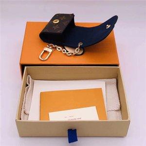 2020 nuevos hombres y mujeres de la cadena de moda clave de auriculares caja de accesorios de automóviles regalo de moda colgante encanto del bolso