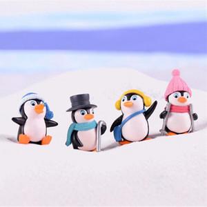 4pcs / set DIY Crafts Mini invierno del pingüino miniatura Figuras de Navidad Figuras para Fairy gnomos del jardín musgo terrarios Decoración