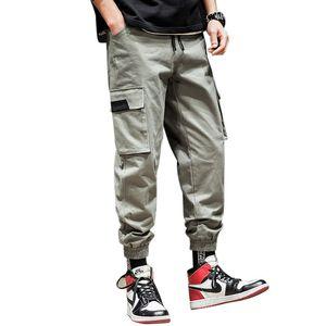La nueva manera ropa de sport de los hombres pantalones flojos monopatín High Street Dark Souls Pantalones Hombres Muti bolsillos de baile pantalones masculinos