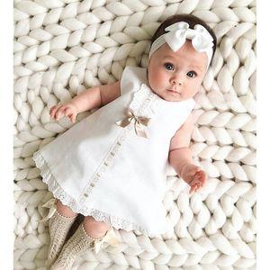 2020 Ropa de bebé verano infantil 0-24 M vestido sin mangas del bebé recién nacido del Bowknot del cordón costilla sólido Shift blanca del vestido de la venda