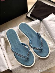 Primavera / verano 2020 nueva mezclilla de eslabones flip-flop damas elegantes metálicos cadena de punto flip-toe sandalias planas casuales zapatillas