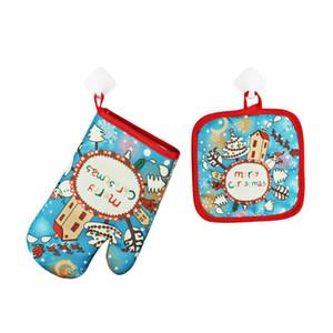 2pcs / set de Navidad linda guantes para hornear anti-calientes + HERRAMIENTA de superficie protectores de la estera del cojín Horno Microondas aislamiento Mat suministro de Navidad