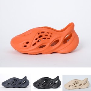 2020 Kanye West Cheap Летнего пляж тапочки пены бегун отверстие горок Bone Сандал Дети обуви мальчик размер девушка молодежь ребенок 24-35