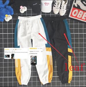 Verão Mens Designer Logo Pants FOLHA Calças de luxo com padrão Painéis solto Cordão calça esporte Casual nove pontos Sweatpants para homens