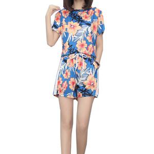 OLN 2019 Femmes Costumes D'été De Mode O-cou T-shirt À Manches Courtes Et Large Jambe Taille Élastique Femme Imprimer Plus La Taille Femmes Ensembles
