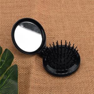 1Pcs Minitaschen-Haar-Kamm-Folding Massagehaarbürste Runde Kamm mit Spiegel Folding Bürste Reise-Bürsten-Verfassungs-Spiegel