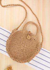 Crianças sacos de palha 2019 fez nova filhos de mão bolsa de rattan de um ombro saco tecido redonda bolsa satchel Vento Bohemia praia círculo J0013