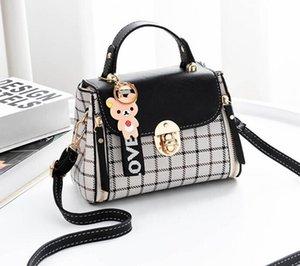 delle donne nuova borsa coreana plaid skew attraverso il piccolo modo un sacchetto di consegna una tendenza di spalla delle donne di stile straniero a casa