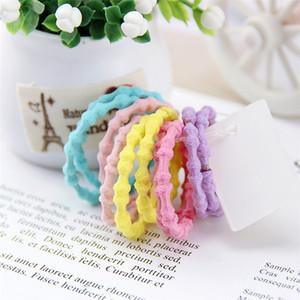 Corda capelli elastici 10pcs / pack neonate Amaretto di colore della caramella dei bambini Elastico Hairband Scrunchie bambini Accessori per capelli E3605