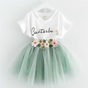 Novos bebê meninas roupas crianças carta impresso t-shirt com flor aplique e chiffon saia verão crianças conjunto de roupas