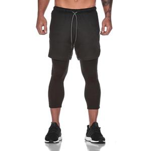Nuevos deportivos Pantalones Hombre elástico y transpirable de dos piezas falso pantalones de entrenamiento Correr gimnasios tobillo de longitud pantalones más tamaño XXXL