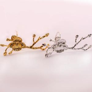 4pcs / lot SHSEJA Squisito prugna tovagliolo rami anello tovaglioli fibbia hotel di lusso tavolo decorazione occidentale tovagliolo cerchio