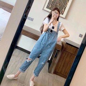 Moda jeans rasgados Harlan atrás los pantalones de las mujeres flojas delgadas para mostrar nueve minutos de los pantalones versión coreana de la reducción de la edad de concatenación de cintura alta
