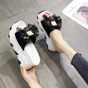 Bow-tie slippers for women wearing a thick bottom 2020 new versatile summer slope with an inside height pine cake lovely sandals