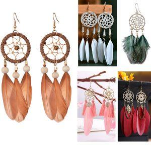 European and American fashion dream catcher feather tassel earrings female ethnic style long hollow earrings handmade jewelry wholesale