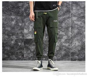 Moda solido con pantaloni larghi da tasca Pantaloni casual con fondo a coste con coulisse Designer HipPop Homme Pantalon