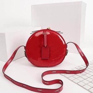 Classico Donne borsa in pelle verniciata Fiori Lettere del cinturino dell'orologio rotonda Torte banchetti Borse a tracolla donne della frizione della borsa a tracolla