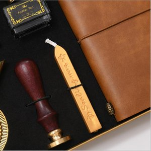 Creative exquisite feather pen wax notebook set with ink bag custom ink tube pen feather wax seal gift box wholesale.