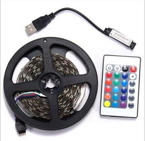 Fábrica 5m RGB llevó la tira SMD 3528 impermeable 300 luz de tira llevada + 24 IR de las llaves remoto + fuente de alimentación de 12V 2A envío libre