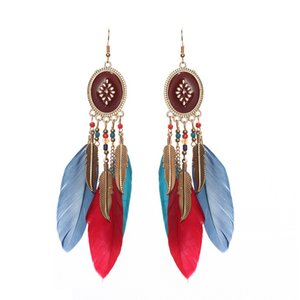 Explosion earrings European and American fashion jewelry creative oval long tassel feather earrings retro chain rice beads earrings