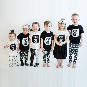 اطفال اطفال الشكل رسائل طباعة تي شيرت الأعلى تيز بنين بنات أسود أبيض بلايز الوظائف الصيفية للأطفال بلوزة تي شيرت الملابس القطن D3303