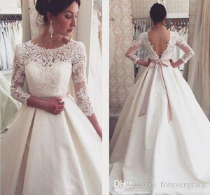 2019 Dubai Arabic 3 4 Long Sleeves Wedding Dress A Line Lace Appliques Backless Country Garden Bride Bridal Gown Custom Made Plus Size