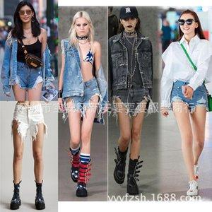 Flores y estrellas jóvenes en pantalones cortos mismos rI3 niño mendigo femenina Feng Shui lavado rebabas rasgados jeans cortos