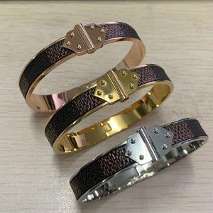 Alta calidad famosa Marca 316 L de acero inoxidable, plata, oro rosa, súper marrón, damas de cuero, hombres, mujeres 19 cm doble flecha brazalete