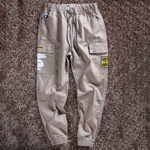 Designer Mens pantaloni Autunno Style Marca Pantaloni Modello Stampato Mens casuali Pocket Solid pantaloni di marca di modo di sport pantaloni lunghi Joggers
