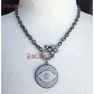 Gunmetal Gold Pavimenta CZ Crystal Evil Eye Disk Ciondolo Big Flower Clasp su Gun Black Chain Girocollo Collana NM18382