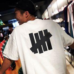 Calle Nueva INVICTO Camisetas para hombre de la marca diseñadores de camisetas de manga corta ocasional de Hip Hop de gran tamaño T-shirts para hombres mujeres pareja w / TagLabel