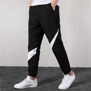 Los nuevos Mens Marca diseñador de los pantalones de cuerpo entero del basculador Pantalones deportivos delgada del remiendo sudoríparas Cordón elástico de las bragas Deportes Blanco Rojo Negro C1 B101029L