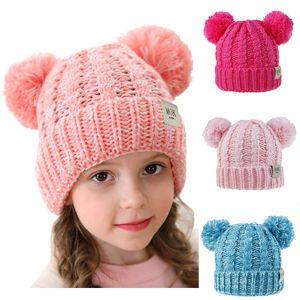 Çocuk Şapkası Yün Örgü Şapka Sonbahar ve Kış Yeni Twist Dokuma Çift Topu Saç Ball Cap Erkekler ve Kızlar Şapka