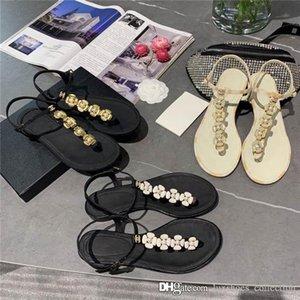 Le printemps et l'été nouvelle petite perle de camélia sandales plates correspondant orteil embelli de camélias délicates pour les femmes