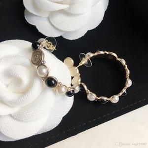 Европейские и американские обычай жемчужные серьги горячего сбывания новое кольцо черный и белый жемчуг серьги