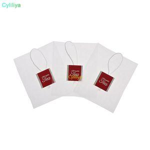 La bustina del tè della piramide filtra la bustina di nylon della bustina di tè singola con le bustine di tè vuote trasparenti dell'etichetta