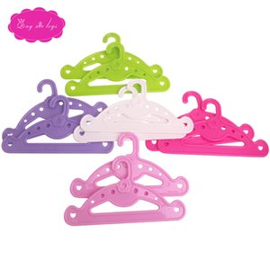 Cute clothes-hangers in a variety of colors are perfect for hanging clothes with 18-inch American toys