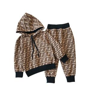 Na Venda 2018 Outono E Inverno Novo Padrão Tendência Masculino Menina Movimento Lazer Moda Terno Crianças Roupas Infantis Vestidos