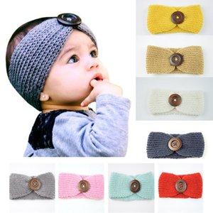 Los nuevos bebés lanas de la manera venda del ganchillo Knit Hairband con el botón de la decoración de invierno recién nacido calentador del oído Cabeza Headwrap 13 colores M570
