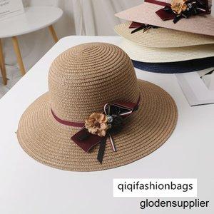 Plaj çocuk yaz çiçek Güneşin güneş kremi hasır şapka yüz gölgeleme gelgit toplu