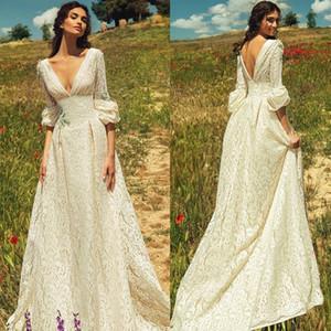 New Romantic Bohemian Lace Backless Abiti da sposa scollo a V maniche lunghe Garden Beach Abiti da sposa Fairy Sweep Train anni '70 Hippie Boho