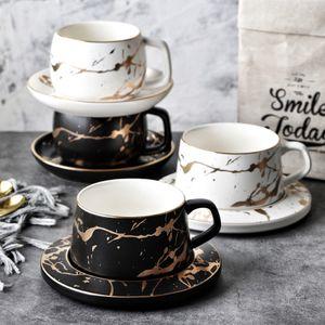 Keramik MUZITY Kaffeetasse und Saucer Kreative Goldener Entwurf Porzellan-Tee-Schalen-Set mit Edelstahl 304 Löffel SH190928