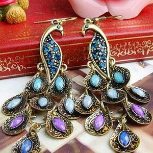 Ms Retro accessories earring  peacock Open screen Earrings  Nationality style Earrings exaggerated ear hooks Factory direct sales