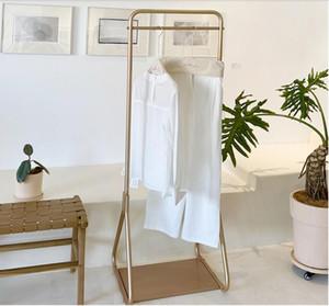 Yatak odası giysi zemin giysi kuzey Avrupa yatak odası asılı kumaş rafları kat ev döşeme küçük elbise basit raf raf raf