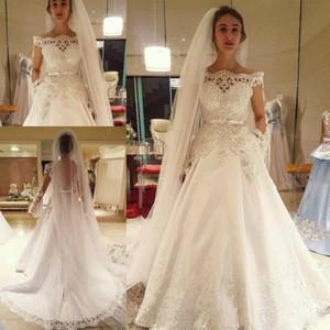 Abiti da sposa in pizzo a manica lunga squisita Bateau Neck Illusion Sheer 2019 Plus Size Arabo Applique vestido de noiva Abito da sposa Palla Personalizzata