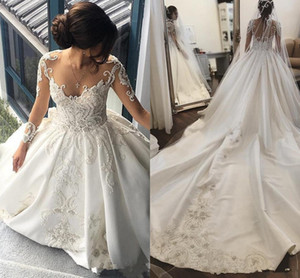 Luxo Dubai Wedding Dresses A Linha Jewel Neck Illusion mangas compridas Lace apliques de contas Catedral Trem Plus Size Formal vestidos de noiva