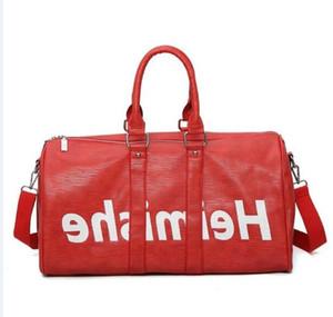 Top qualidade do couro genuíno novo saco de viagem dos homens da forma Mulheres duffle saco, desenhista marca bagagem bolsas saco de desporto grande capacidade