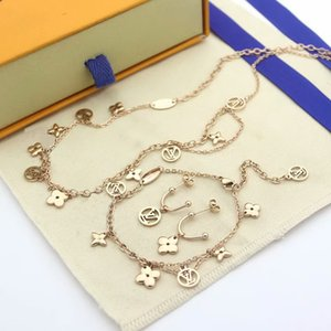 مجموعات أزياء ومجوهرات النساء التيتانيوم الصلب الشرابة الجوف خارج متعددة ورقة أربعة مجموعات زهرة V الأحرف الأولى 18K الذهب قلادة سوار أقراط